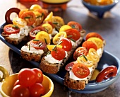 Olive bread topped with soft cheese & cocktail tomatoes