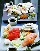 Sashimi with sea bass and with oysters, tuna and salmon
