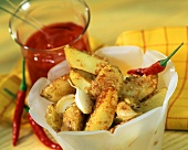 Potato triangles with spicy, crispy panade and garlic