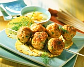 Fried salmon dumplings on kebab and pineapple sauce