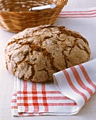 Farmhouse bread on a kitchen cloth