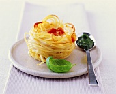 Spaghetti nest with tomatoes and mozzarella