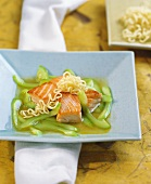 Salmon fillet with stock with cucumber
