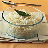 Cooked basmati rice in a glass dish on kitchen cloth