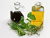 Aceto balsamico, oil, herbs (ingredients for herb vinaigrette)