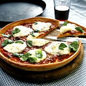 Pizza Margherita on a wooden plate