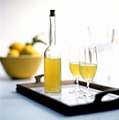 Bottle of Limoncello with two glasses on tray