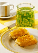 Bread with mango & melon jam, jar of mango & kiwi fruit jelly