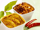 Mango chutney and pumpkin chutney in bowls