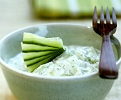 Bowl of tzatziki with cucumber fan