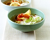 Asian rice noodle soup with spring onions and shrimps