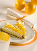 Two pieces of orange cream sponge gateau