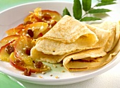 Filled pancakes (Palatschinken) with warm apple salad