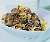 Sweet poppy seed noodles with walnuts and orange segments
