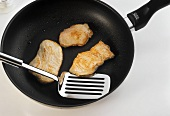 Frying escalope in a frying pan