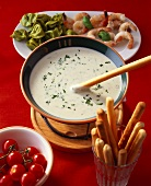 Italian style cheese fondue (with tortellini, shrimps, grissini)