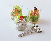 Three deli salads served in glass