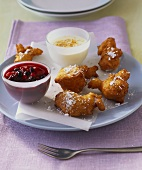 Doughnuts with berry- and coconut sauce