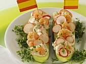 Cucumber boats with radish and shrimp filling and cress