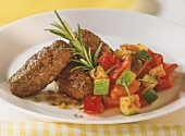 Cevapcici (mince rolls) with Mediterranean vegetables