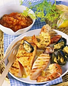Creole barbecued seafood platter with salsa criolla