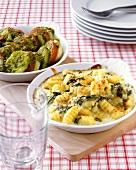 Rocket and gnocchi gratin and vegetable and dumpling bake