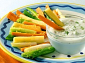 Braised vegetable sticks with yoghurt and walnut dip