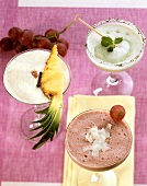 Three alcoholic milkshakes (coconut, grape and pineapple)