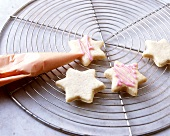 Decorating star biscuits with piping bag