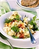 Marinated cauliflower with chopped egg and ham sauce