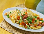 Fried rice with ham, carrots, peas and egg