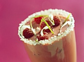 Berry shake with raspberries and grated coconut