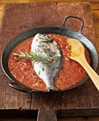 Fish with almonds, white and tomato sauce (con almendras)