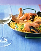 Paella valenciana with chicken and seafood