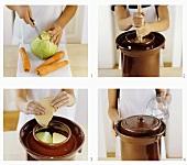 Preparing carrot sauerkraut in fermenting pot