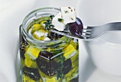 Sheep's cheese with olives in olive oil