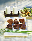 Curried beef sate with wok-cooked vegetables