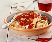 Spaghetti with spicy tomato sauce and ricotta