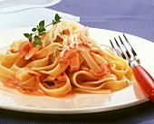 Fettuccine al prosciutto (Pasta with tomato sauce and ham)