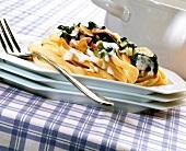 Tagliatelle with ham and spinach in cream sauce