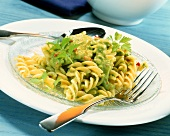 Fusilli with avocado sauce and coriander leaves