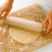 Rolling out pastry between clingfilm