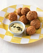 Deep-fried fish balls in batter with caper and mustard sauce