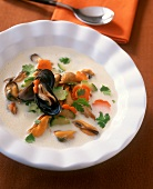Mussel soup with vegetable flowers