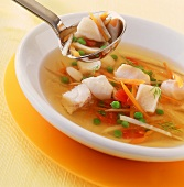 Clear fish soup with coley and vegetables