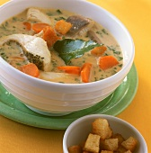 Fish soup with carp, carrots and croutons