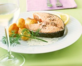 Peppered salmon steak with dill sauce and potatoes