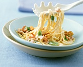 Spaghettini with shrimp sauce, walnuts and basil