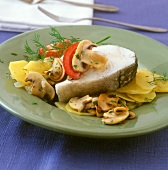 Pan-cooked fish dish (haddock with tomatoes and mushrooms)