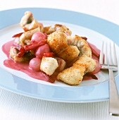 Eel in red wine with pearl onions and beetroot